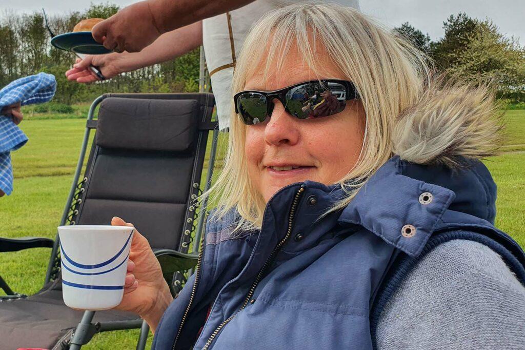 anne drinks tea at Manor Farm camping Cromer