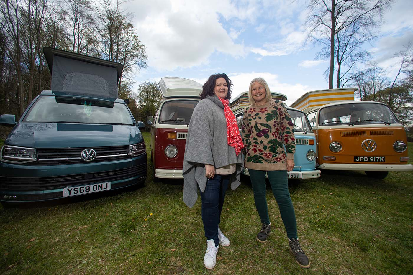 Anne with Debbie and their vans