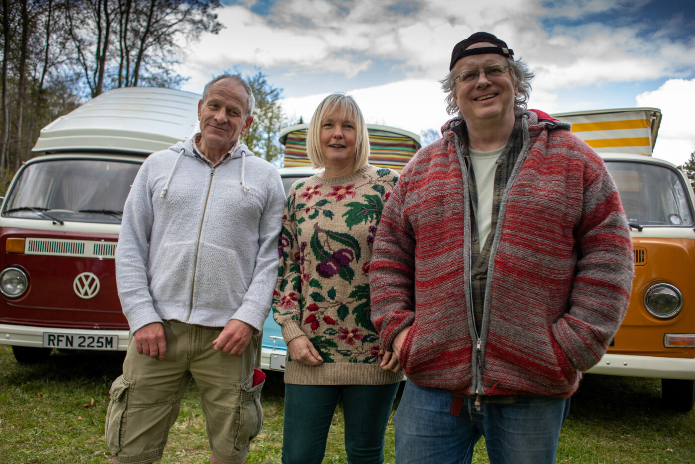 anne dave and tref in front of their vw campervans