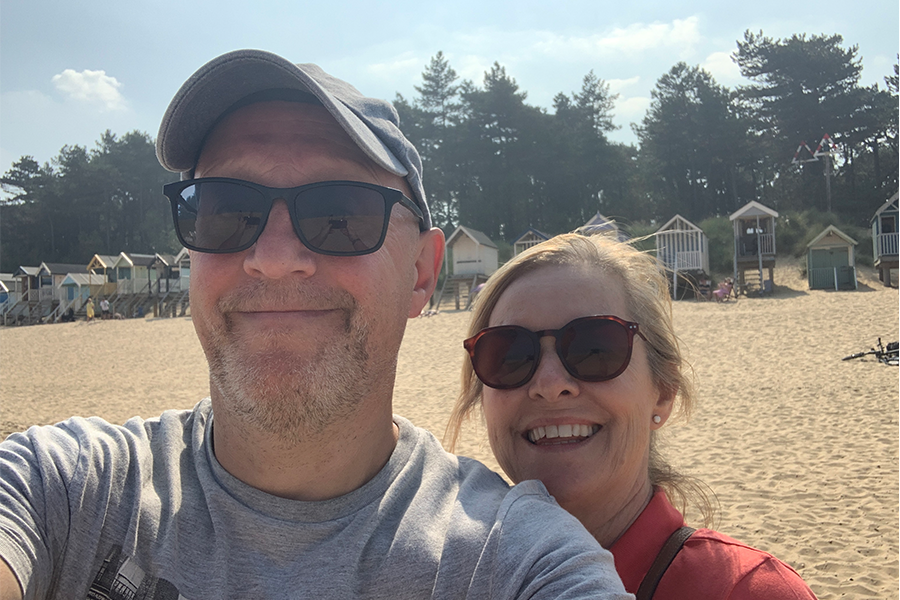 Alison and Louigi on the beach during their trip in our cost campervan Bertie